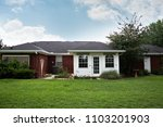 1980's brick ranch house in the ... | Shutterstock . vector #1103201903