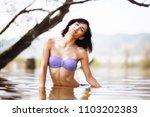 sexy girl posing in water.... | Shutterstock . vector #1103202383