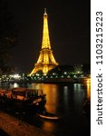 Small photo of Paris, France - june 09, 2008: Eiffel Tower illuminated at dusk over the Seine River, in the urban center of the city