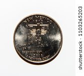 Small photo of A quarter dollar (25 cents) coin with the image of New Mexico (Land of Enchantment), USA