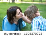 mom or grandmother calms a son... | Shutterstock . vector #1103270723