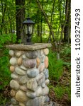 lantern lamp rock pillar... | Shutterstock . vector #1103274293