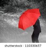 Businessman With Red Umbrella...