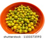 Small photo of An isolated bowl of Nanche (or nance) fruit. Native to tropical America, it is sweet and strongly scented.