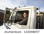 Middle aged man driving truck - stock photo