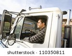 Man driving truck - stock photo