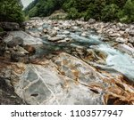 stony bed  teal water   the... | Shutterstock . vector #1103577947