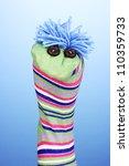 cute sock puppet on blue... | Shutterstock . vector #110359733
