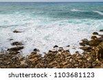 seascape. sea foam and stony... | Shutterstock . vector #1103681123