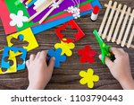 a child is cutting details of a ... | Shutterstock . vector #1103790443