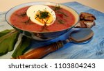 Small photo of Beet green soup with egg and slice of bread.
