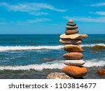 stones in the pyramid stand on... | Shutterstock . vector #1103814677