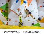 rock climbers in climbing gym....   Shutterstock . vector #1103823503