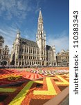 BRUSSELS, BELGIUM-AUGUST 15: African theme Flower Carpet attracted tourists from different countries to Grand Place on August 15, 2012 in Brussels. This is biennial event with different themes. - stock photo