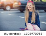 a fashionable little cute girl... | Shutterstock . vector #1103970053
