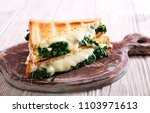 spinach and cheese toasted...   Shutterstock . vector #1103971613