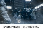 Stock photo medieval battle viking warriors break into wooden fortress yard and fight with slavs guards 1104021257