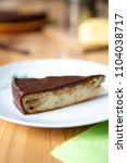 Small photo of Cheese cake with Ines Rosales, olive oil and chocolate topping