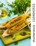 Small photo of Whole corn cob grilled in husk with pesto and coriander