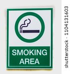 Small photo of Signs symbolize Smoking area on white background , soft focus , blurred , isolated.