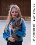 beautiful blonde woman holding...   Shutterstock . vector #1104196733