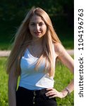 sbeautiful blonde girl in a...   Shutterstock . vector #1104196763