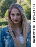 beautiful blonde girl in denim...   Shutterstock . vector #1104196793