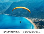 paragliding in the sky.... | Shutterstock . vector #1104210413