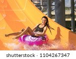 pretty woman on the rubber ring ... | Shutterstock . vector #1104267347