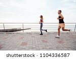 side view of sportive couple ... | Shutterstock . vector #1104336587