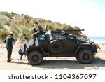 Small photo of Saunton, Devon, UK - 3rd June 2018: World War 2 reenactment (D-day) weekend. Actors in German infantry uniform around and on a period WW2 German armoured scout car.