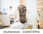 back view of patient with eeg... | Shutterstock . vector #1104373943