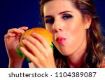 woman eating sandwich. girl... | Shutterstock . vector #1104389087