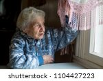 an elderly woman in the house... | Shutterstock . vector #1104427223