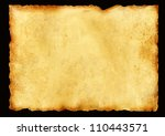 Old parchment. Isolated over black - stock photo