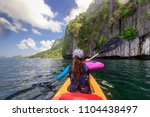 woman paddling a kayak in the...   Shutterstock . vector #1104438497