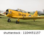 """Small photo of Peru, Illinois, USA - May 19, 2018 T-6 Texan """"Spanish Lady"""" trainer parked on grass at the TBM Avenger Salute to Veterans"""