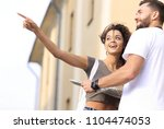 happy man showing something to... | Shutterstock . vector #1104474053