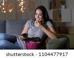 happy woman watching tv in the... | Shutterstock . vector #1104477917
