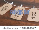 child's drawing on tags hanging ... | Shutterstock . vector #1104484577