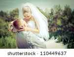 groom and bride in a park.... | Shutterstock . vector #110449637
