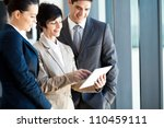 group of business people using tablet computer in office - stock photo