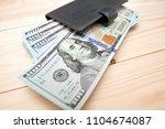 heap of money and wallet. money ...   Shutterstock . vector #1104674087