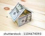 dollars money in the shape of a ...   Shutterstock . vector #1104674093