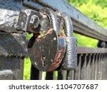 Small photo of Old padlocks on the bridge in summer. Love padlock