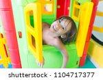 cute happy little boy at... | Shutterstock . vector #1104717377