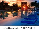 Pavilion on a sunset and the pool with reflection. - stock photo