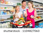 happy family customers choosing ... | Shutterstock . vector #1104827063