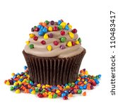 Chocolate cupcake topped with colorful sprinkles.  Isolated on white. - stock photo