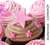 Chocolate cupcake with pink stars. - stock photo